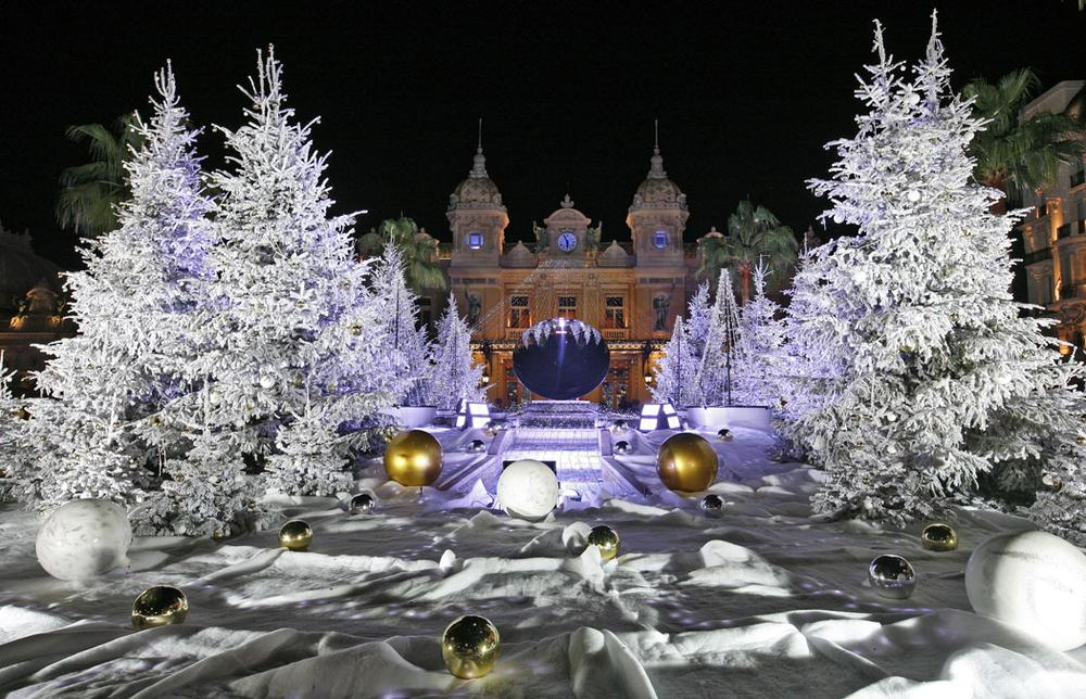 Snow white trees decorate the front of the Monte Carlo Casino in Monaco for Christmas and New Year's on Dec. 11, 2013. (AP Photo/Lionel Cironneau)