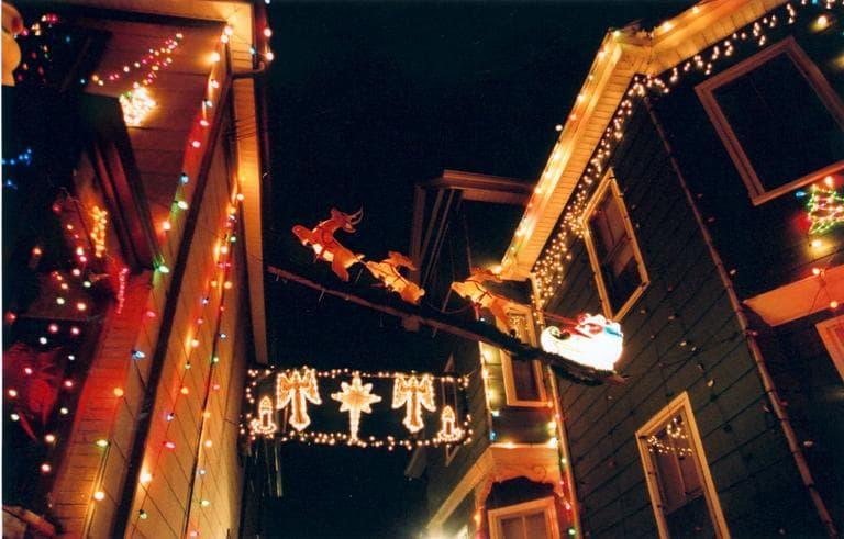 Reindeer pull Santa's sleigh over John Ragno's Otis Street driveway. (Somerville Arts Council)