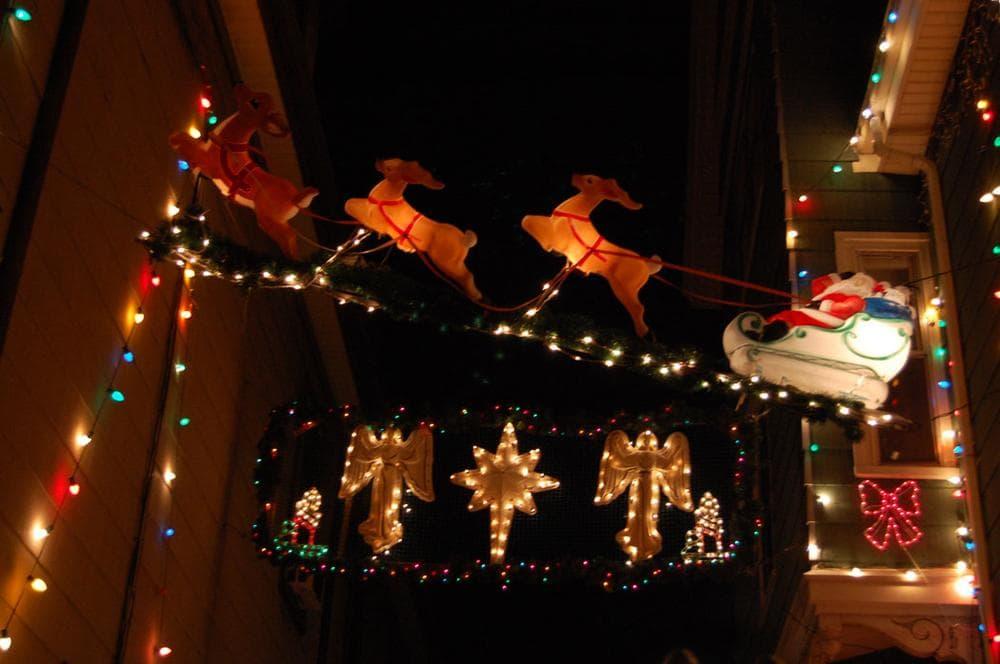 Reindeer pull Santa's sleigh over John Ragno's driveway on Otis Street in Somerville. (Greg Cook)