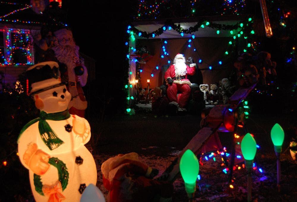 Santa waves on Washington Street in Melrose. (Greg Cook)