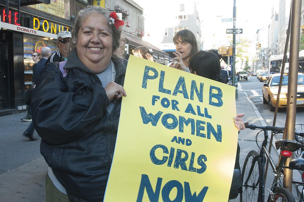 A woman at a flash mob protest demands better access to the morning after pill (lalvanova/Flickr)