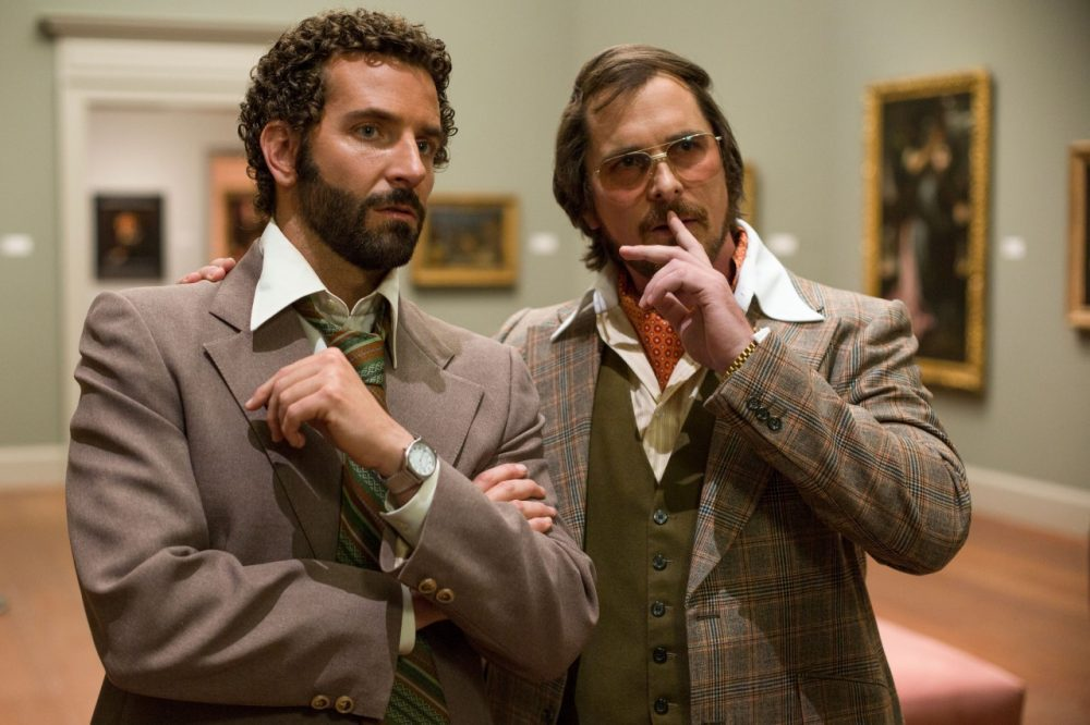 "Bradley Cooper (left) as FBI Agent Richie DiMaso in the film, ""American Hustle."" Christian Bale, (right) as conman Irving Rosenfeld. (Sony Pictures)"