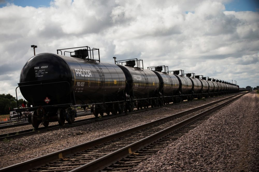 Oil containers sit at a train depot on July 26, 2013 outside Williston, North Dakota. Concerns have been raised that the oil extracted from the Bakken Shale in North Dakota is more hazardous than conventional crude oil. (Andrew Burton/Getty Images)