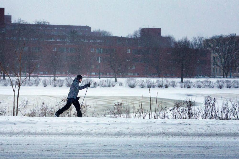 A man skis along Memorial Drive Friday morning.