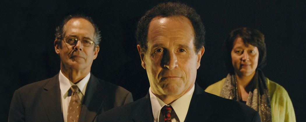 From left to right, Joel Colodner as Solomon Galkin, Jeremiah Kissel as Bernard Madoff, Adrianne Krstansky as a secretary. (Courtesy New Rep Theatre)