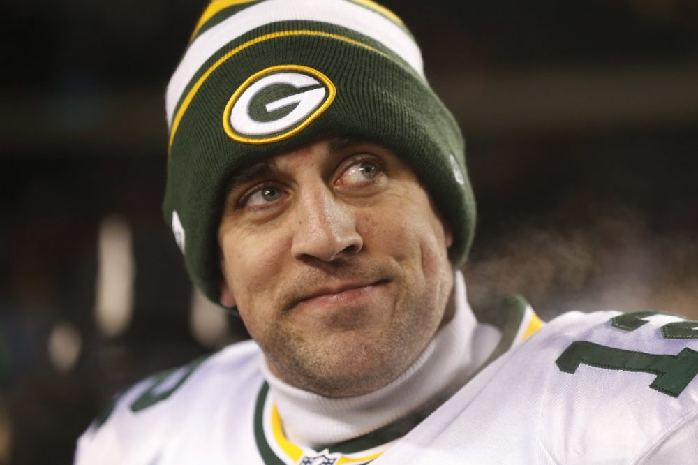The week before his team's playoff game, Aaron Rodgers responded to rumors about his sexuality. (Charles Rex Arbogast/AP)