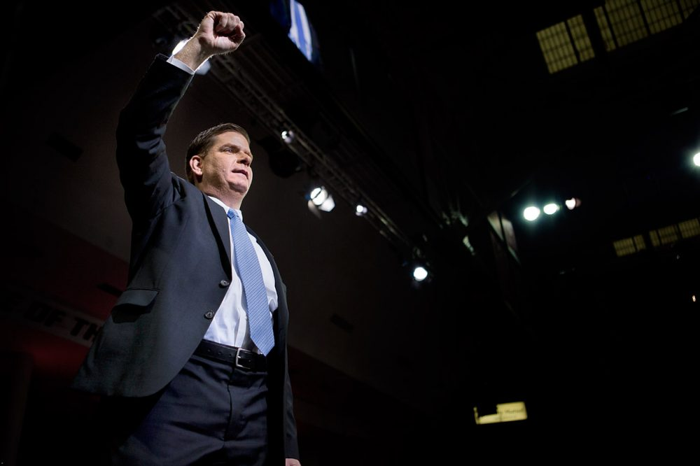 New Boston Mayor Martin Walsh salutes the crowd at his inauguration Monday at Boston College. (Jesse Costa/WBUR)