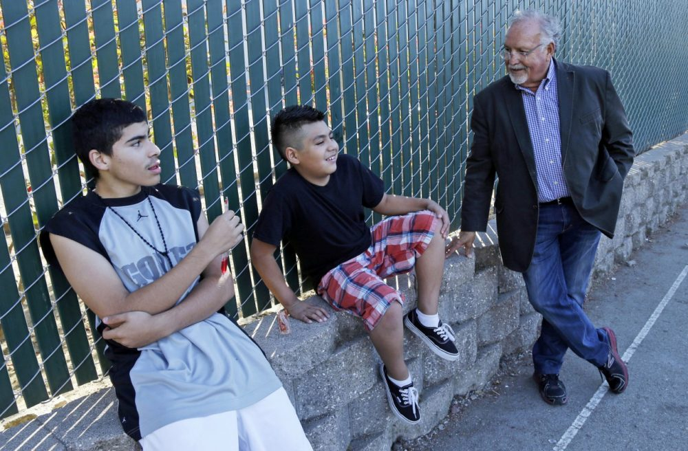 Realtor Tony Campos, right, Watsonville's first Latino elected official, chats with Brian Chavez, center, and Oscar Gomez at an affordable housing complex for farmworkers and their children in Watsonville, Calif., July 19, 2013. As the Golden State becomes less and less white, communities are becoming more segregated, not less. (Marcio Jose Sanchez/AP)