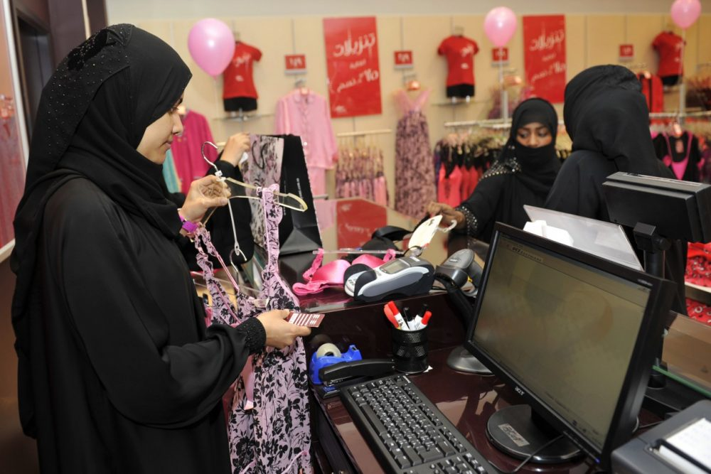 Fully-veiled Saudi women shop at a lingerie store in the Saudi Red Sea port of Jeddah on January 2, 2012. From this week, only female staff will be able to sell women's lingerie in Saudi Arabia, ending decades of awkwardness in the ultra-conservative Muslim kingdom where women are expected to don black cloaks at all times out of the home. (Amer Hilabi/AFP/Getty Images)