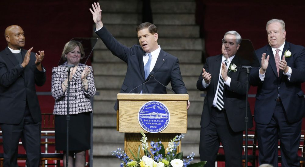 Boston Mayor Marty Walsh waves after giving his inaugural address in Conte Forum at Boston College in Boston, Monday, Jan. 6, 2014. (Michael Dwyer/AP)