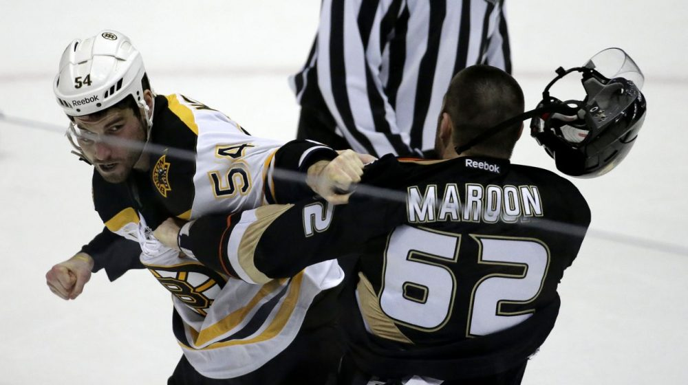Bruins defenseman Adam McQuaid, left, and Anaheim Ducks' Patrick Maroon brawl during the second period. (AP/Chris Carlson)