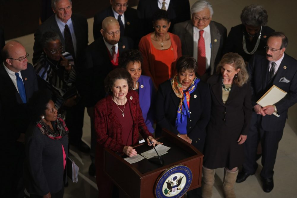 Lynda Johnson Robb, daughter of President Lyndon Johnson and wife of former Sen. Chuck Robb (D-Va.), is joined by Democratic members of the House of Representatives during an event marking the 50th anniversary of the start of the War on Poverty at the U.S. Capitol Visitors Center January 8, 2014 in Washington, DC. (Chip Somodevilla/Getty Images)