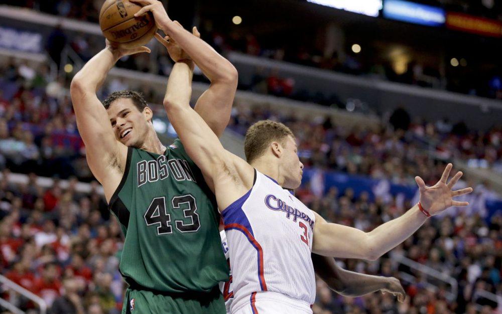 Boston Celtics forward Kris Humphries, left, pulls a rebound away from Los Angeles Clippers forward Blake Griffin. (AP/Chris Carlson)