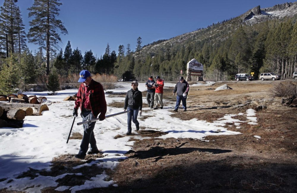 Frank Gehrke, chief of snow surveys for the California Department of Water Resources, left, leads his group out to measure snow levels near Echo Summit, Calif., on Friday, Jan. 3, 2014. (Steve Yeater/AP)