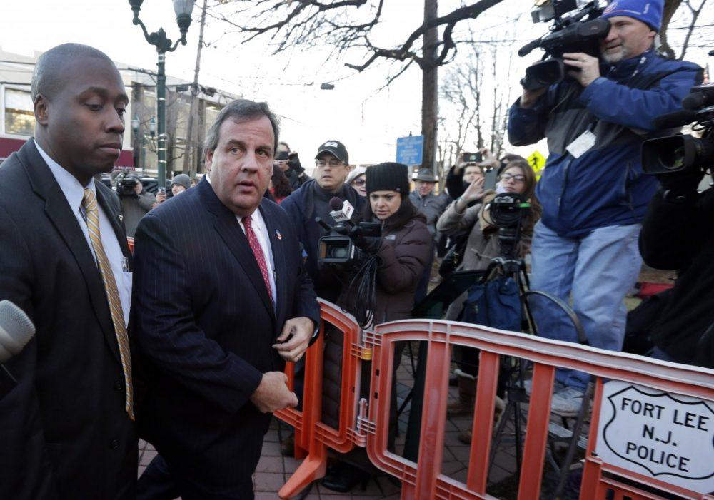 "New Jersey Gov. Chris Christie, second left, arrives at Fort Lee, N.J., City Hall, Thursday, Jan. 9, 2014. Christie traveled to Fort Lee to apologize in person to Mayor Mark Sokolich. Moving quickly to contain a widening political scandal, Gov. Chris Christie fired one of his top aides Thursday and apologized repeatedly for the ""abject stupidity"" of his staff, insisting he had no idea anyone around him had engineered traffic jams to get even with a Democratic mayor. (Richard Drew/AP)"