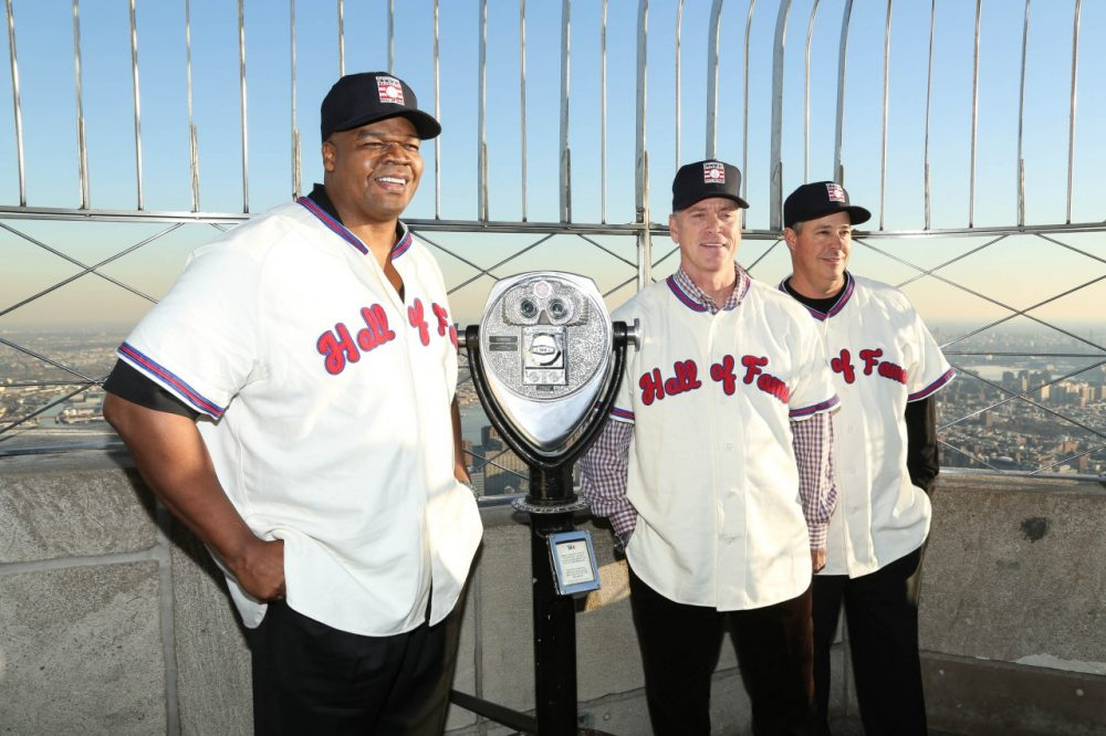 Frank Thomas, Tom Glavine, and Greg Maddux pose atop the Empire State Building. The trio will meet again in Cooperstown. (Rob Kim/Getty Images)