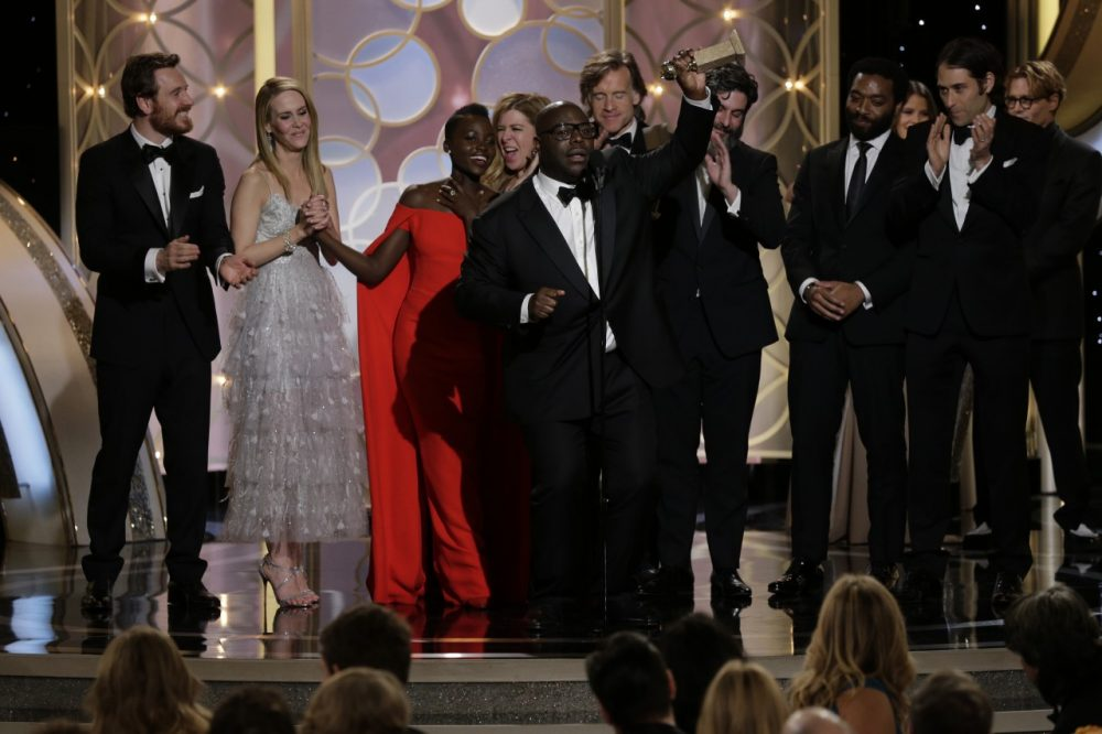 "Steve McQueen and the cast of ""12 Years A Slave"" accept the award for Best Motion Picture, Drama during the 71st Annual Golden Globe Award at The Beverly Hilton Hotel on January 12, 2014 in Beverly Hills, California. (Photo by Paul Drinkwater/NBCUniversal via Getty Images)"