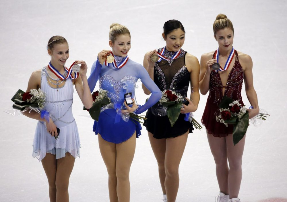 From left, Polina Edmunds (second place) Gracie Gold (first place), Mirai Nagasu (third place) and Ashley Wagner (fourth place) pose with their medals after finishing as the top four women at the U.S. Figure Skating Championships in Boston. (Elise Amendola/AP)