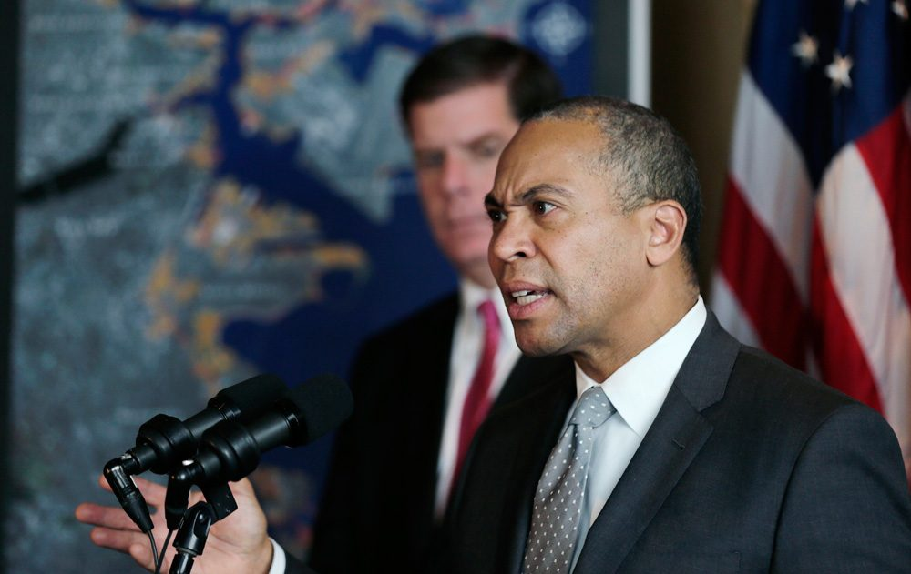 Gov. Deval Patrick speaks during a Jan. 14 news conference on his $50 million plan to take on the challenges of climate change. (Charles Krupa/AP)