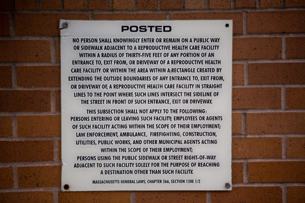 A sign posted on the wall of Planned Parenthood informs people about the 35-foot buffer zone law. (Jesse Costa/WBUR)