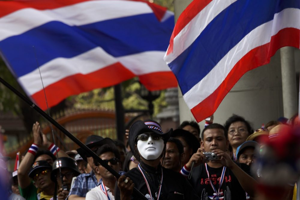 Anti-government protesters demonstrate in front of the Royal Thao Police headquarters on January 14, 2014 in Bangkok, Thailand. (Ed Wray/Getty Images)