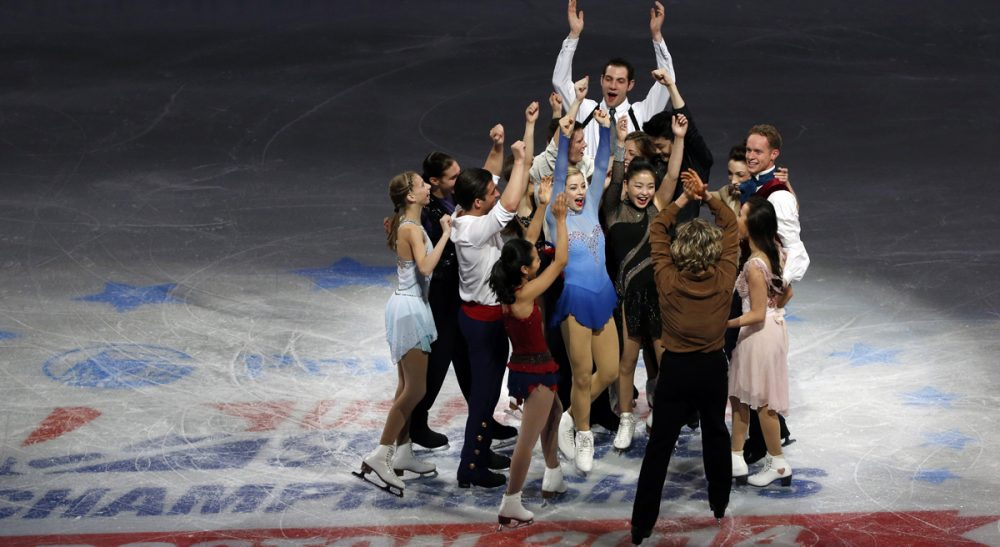 The U.S. Olympic figure skating team headed to Sochi do a group cheer on mid-ice at the end of their skating spectacular after the U.S. Figure Skating Championships in Boston, Sunday, Jan. 12, 2014. (Elise Amendola/AP)