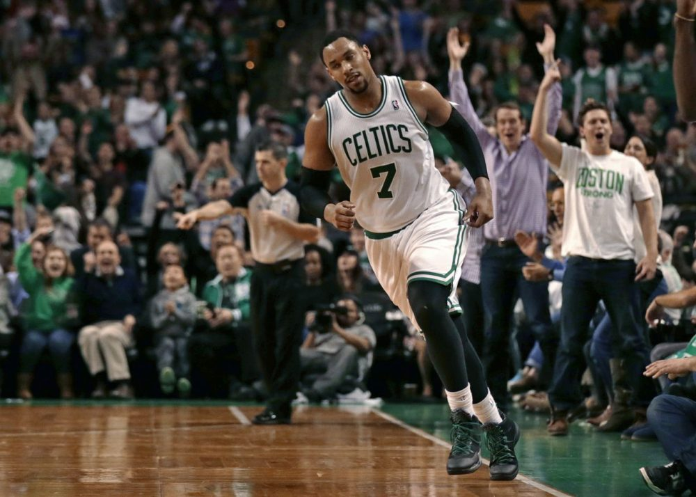 Fans cheer as Boston Celtics forward Jared Sullinger heads upcourt after hitting a basket with time expiring in the third quarter. (AP/Charles Krupa)