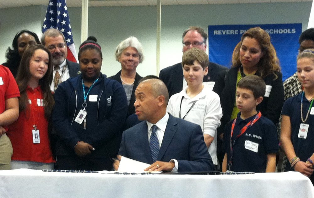 Gov. Deval Patrick signs an executive order creating a school safety task force in Revere Thursday. (Jack Lepiarz/WBUR)