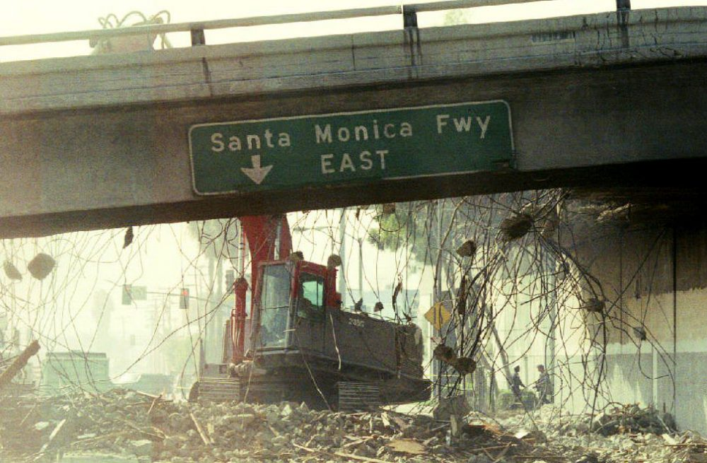 A bulldozer begins to tear down a section of the Santa Monica Freeway, Jan. 19, 1994, that collapsed during the Northridge earthquake. (Tim Clary/AFP/Getty Images)