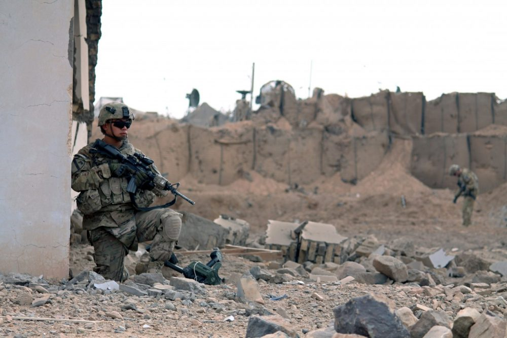 U.S. soldiers inspect the scene of a suicide attack outside a base in Zhari district, Kandahar province on January 20, 2014. (Javed Tanveer/AFP/Getty Images)
