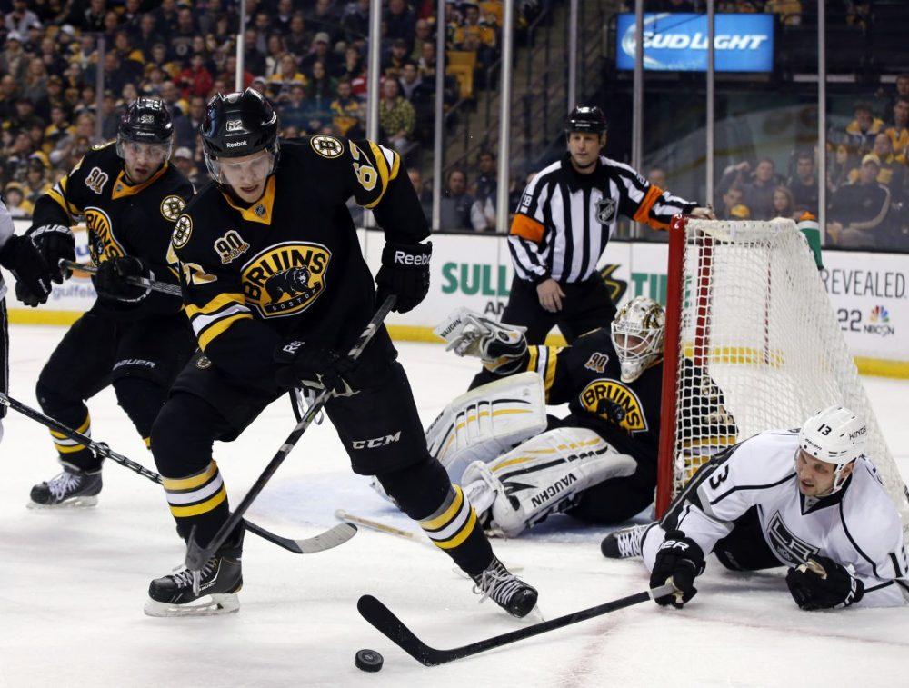 Boston Bruins defenseman Zach Trotman (62) moves to control the puck against Los Angeles Kings left wing Kyle Clifford (13). (AP/Elise Amendola)