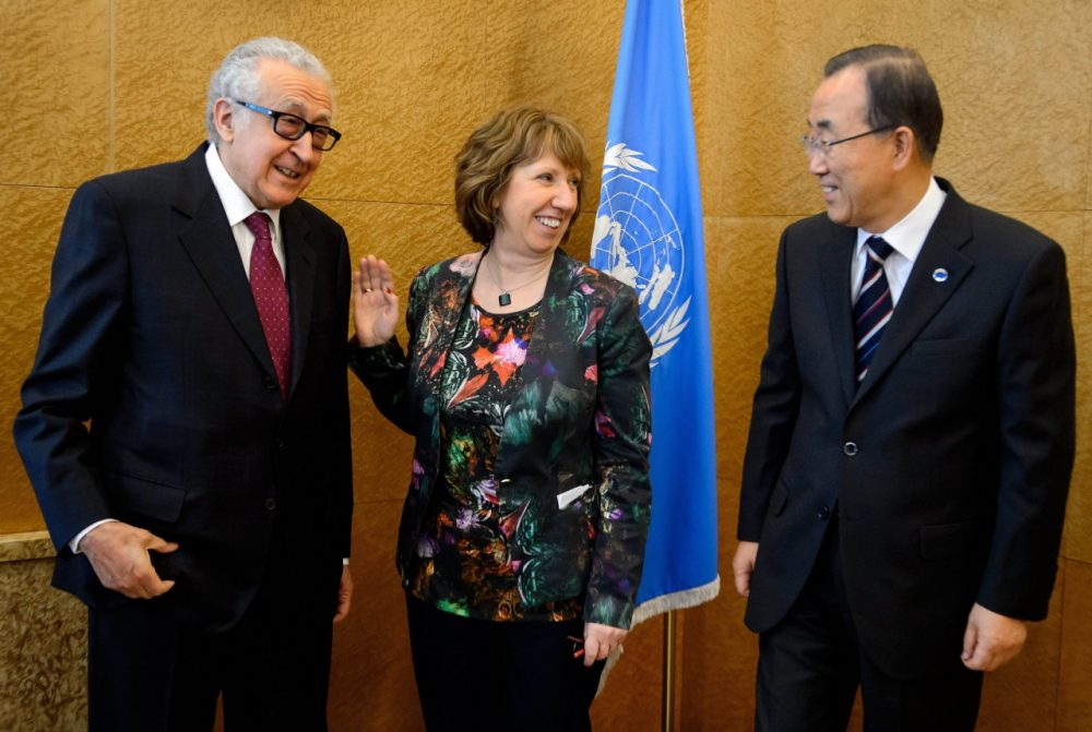 U.N-Arab League envoy for Syria Lakhdar Brahimi, left, European Union Foreign Policy Chief Catherine Ashton and United Nations Secretary General Ban Ki-Moon pose for the media prior to a meeting at the United Nations offices in Geneva, Tuesday Jan. 21, 2014, ahead of the Geneva II conference in Montreux. Russia and Iran criticized the U.N. chief's decision to withdraw Tehran's invitation to join this week's peace conference on Syria, as delegates began to arrive in Switzerland on Tuesday for the long-awaited talks.(Fabrice Coffrini/AP)
