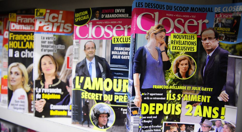 Celebrity news magazines are on display at a Paris newstand, Friday, Jan. 17, 2014. (Zacharie Scheurer/AP)