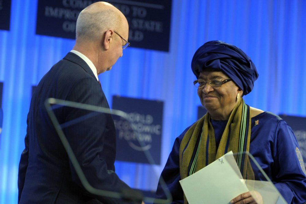 WEF Executive Chairman Klaus Schwab shakes hands with Liberia's President Ellen Johnson-Sirleaf prior to her speech during the World Economic Forum in Davos on January 22, 2014. (Eric Piermont/AFP/Getty Images)