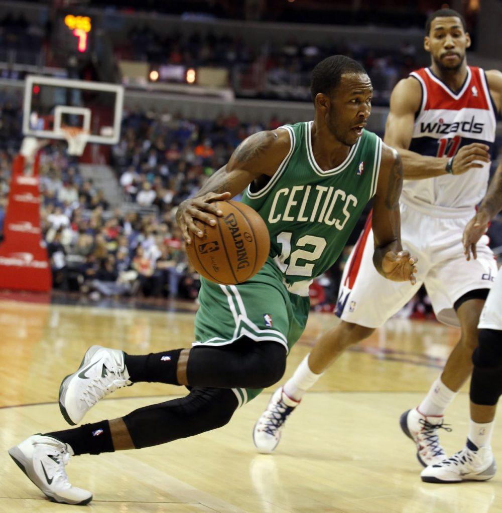 Boston Celtics forward Chris Johnson (12) drives past Washington Wizards guard Garrett Temple (17). (AP/Alex Brandon)