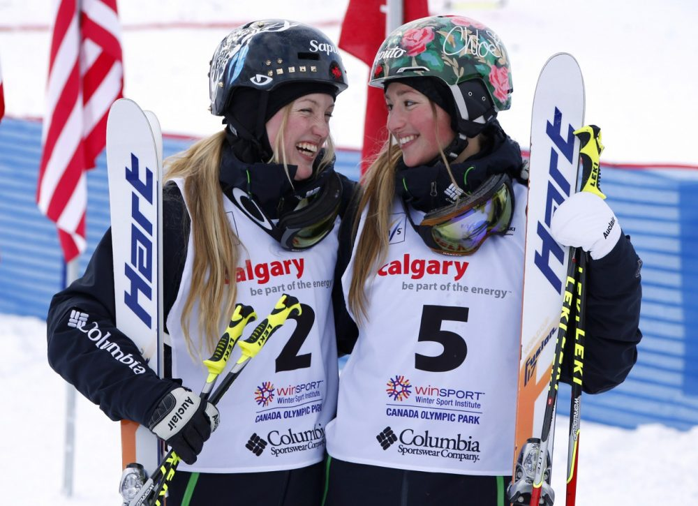 Sisters Justine (L) and Chloe (R) Dufour-Lapointe celebrate each others success. (Todd Korol/Getty Images)