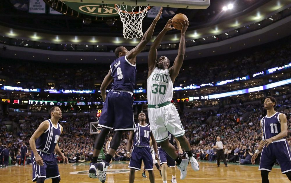 Boston Celtics forward Brandon Bass (30) drives to the basket against Oklahoma City Thunder forward Serge Ibaka (9) during the first half of an NBA basketball game in Boston, Friday, Jan. 24, 2014. (Charles Krupa/AP)