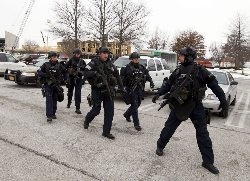 Police move in from a parking lot to the Mall in Columbia on Saturday. (Jose Luis Magana/AP)