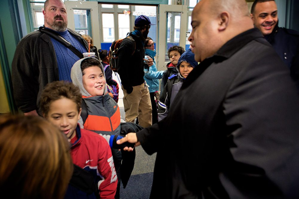New Lawrence Mayor Daniel Rivera, right, greets students at dismissal from the Oliver School. (Jesse Costa/WBUR)