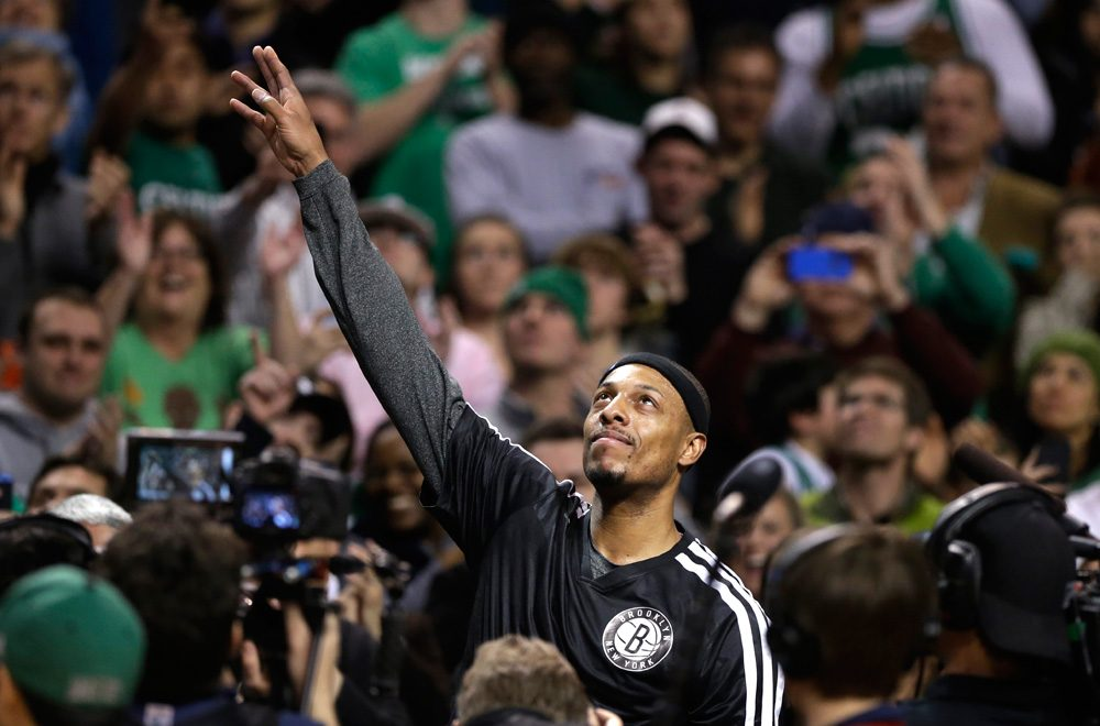 Former Celtics great and current Brooklyn Nets forward Paul Pierce waves to the crowd during a tribute to him Sunday night in Boston. (Steven Senne/AP)