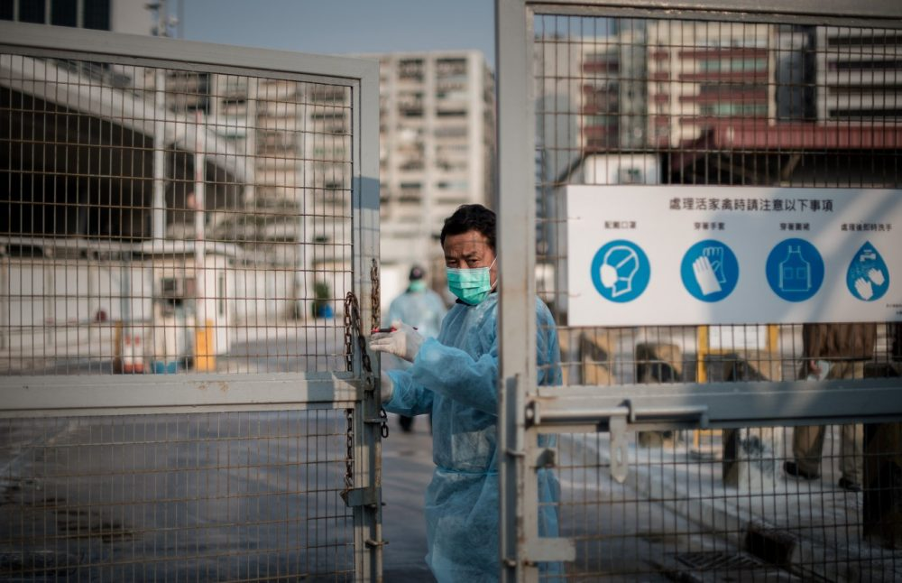 A security guard closes the gate of a live poultry market in Cheung Sha Wan before officials proceed to cull chickens in Hong Kong on January 28, 2014. Hong Kong began a mass cull of 20,000 chickens after the deadly H7N9 bird flu virus was discovered in poultry imported from mainland China, authorities said. (Phillipe Lopez/AFP/Getty Images)
