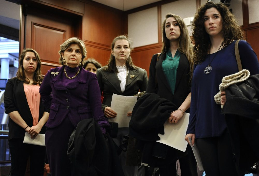 Attorney Gloria Allred, second right, stands with clients Erica Daniels, left, Kylie Angell, center, Carolyn Luby, second from right, and Rosemary Richi. The women, who say they were victims of sexual assaults while students at UConn, have filed a federal discrimination lawsuit. (Jessica Hill/AP)