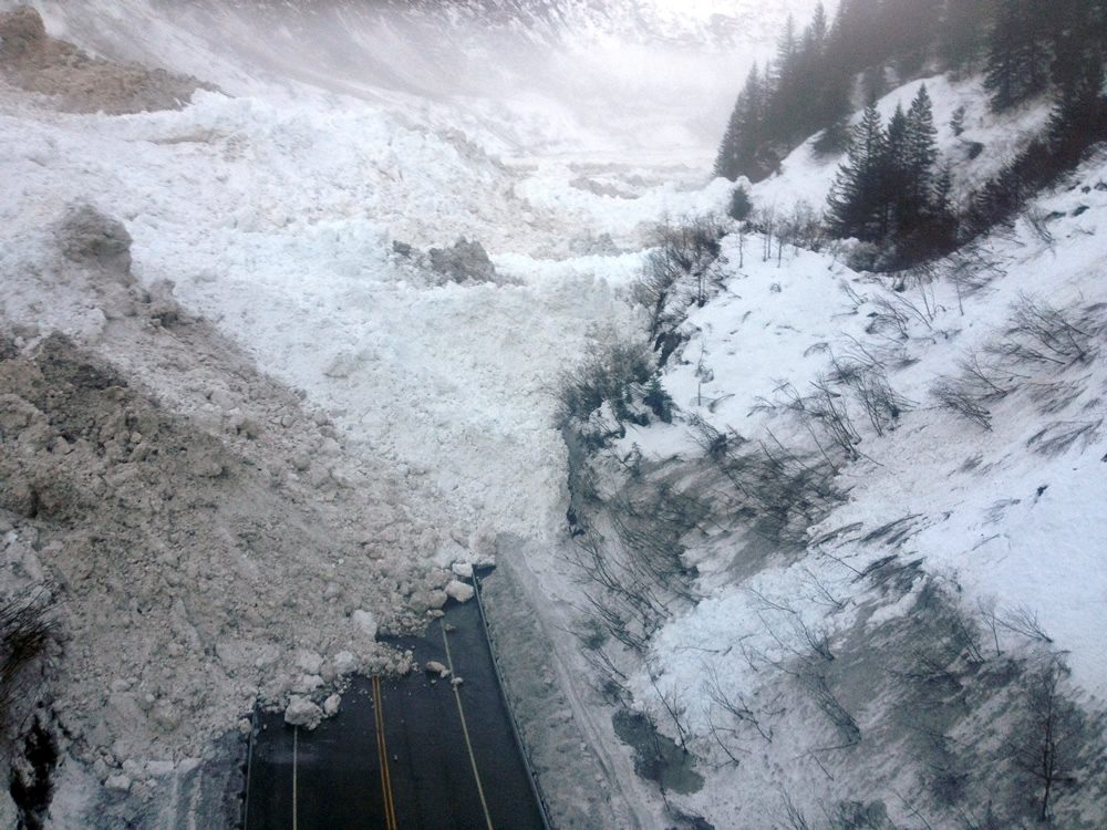 This Jan. 24, 2014 photo shows multiple avalanches that crossed the Richardson Highway in the Thompson Pass region of Valdez, Alaska. (Alaska Department of Transportation & Public Facilities via AP)