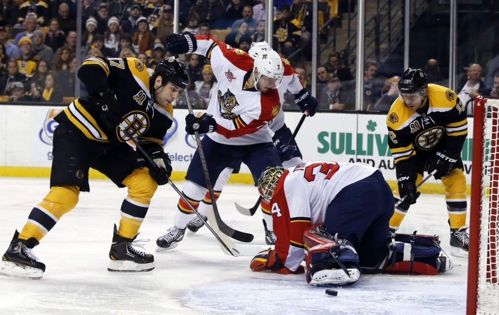 Boston Bruins left wing Milan Lucic (17) moves to a loose puck to score against Florida Panthers goalie Tim Thomas (34) after he falls out of position. (AP/Elise Amendola)