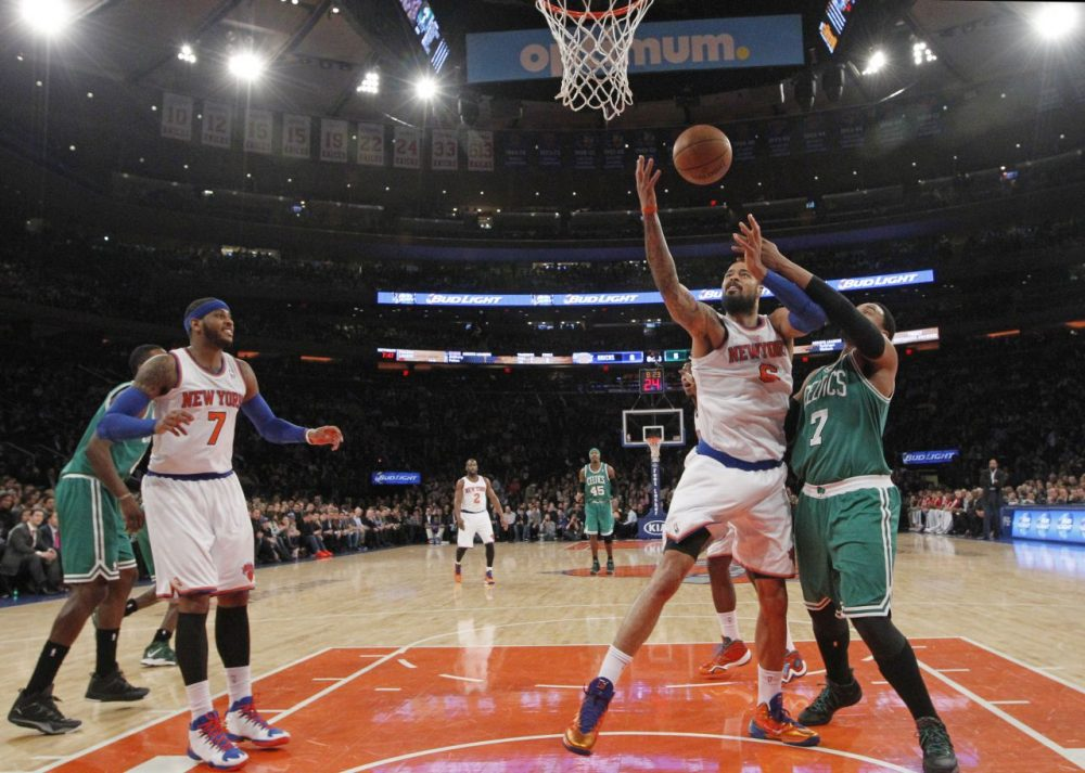 New York Knicks forward Tyson Chandler (6) pulls down a rebound as he battles with Boston Celtics center Jared Sullinger (7) as Knicks forward Carmelo Anthony (7) watches. (AP/Kathy Willens)