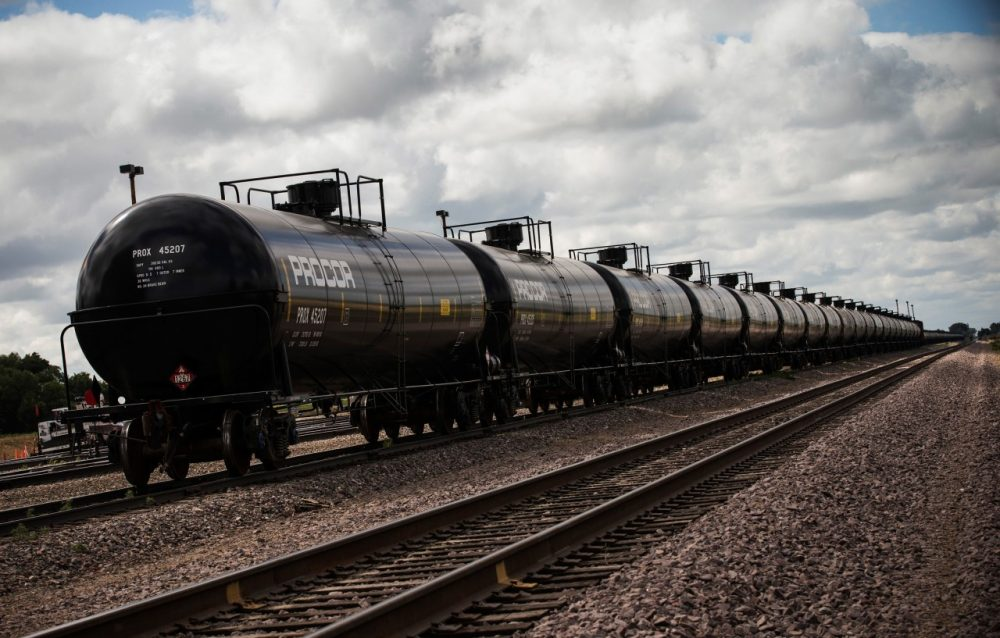 Oil containers sit at a train depot on July 26, 2013 outside Williston, North Dakota. (Andrew Burton/Getty Images)