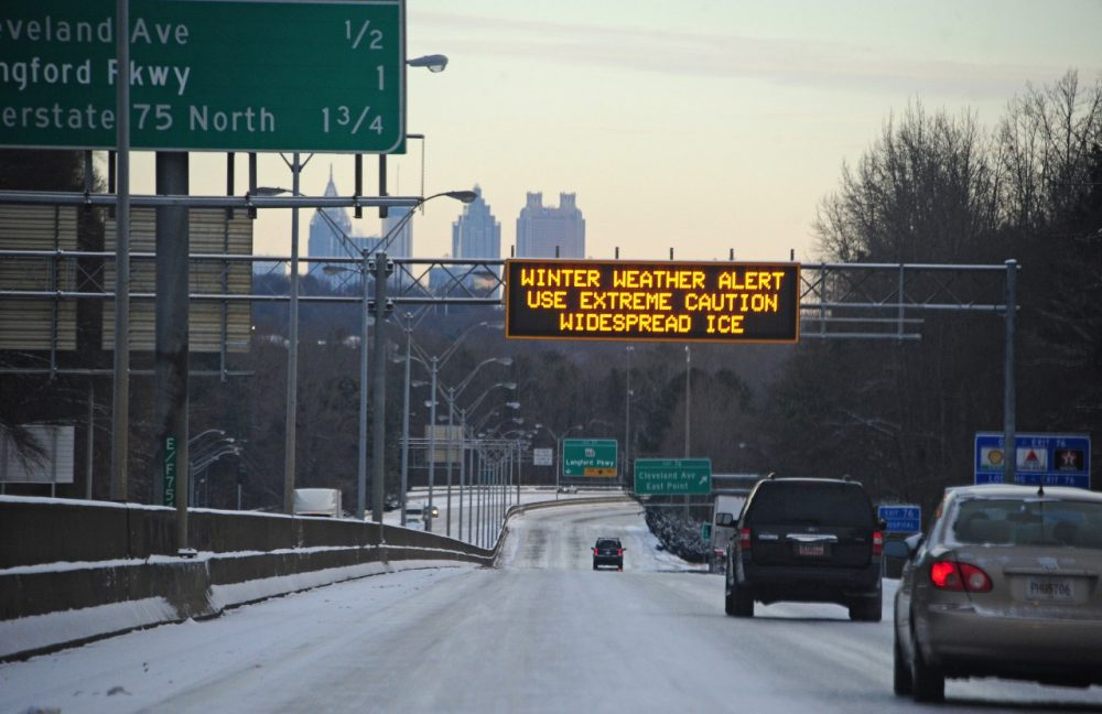 A sign warns of a winter weather alert along Interstate 75 in icy conditions January 29, 2014 in Atlanta, Georgia. (Scott Cunninghaml/Getty Images)