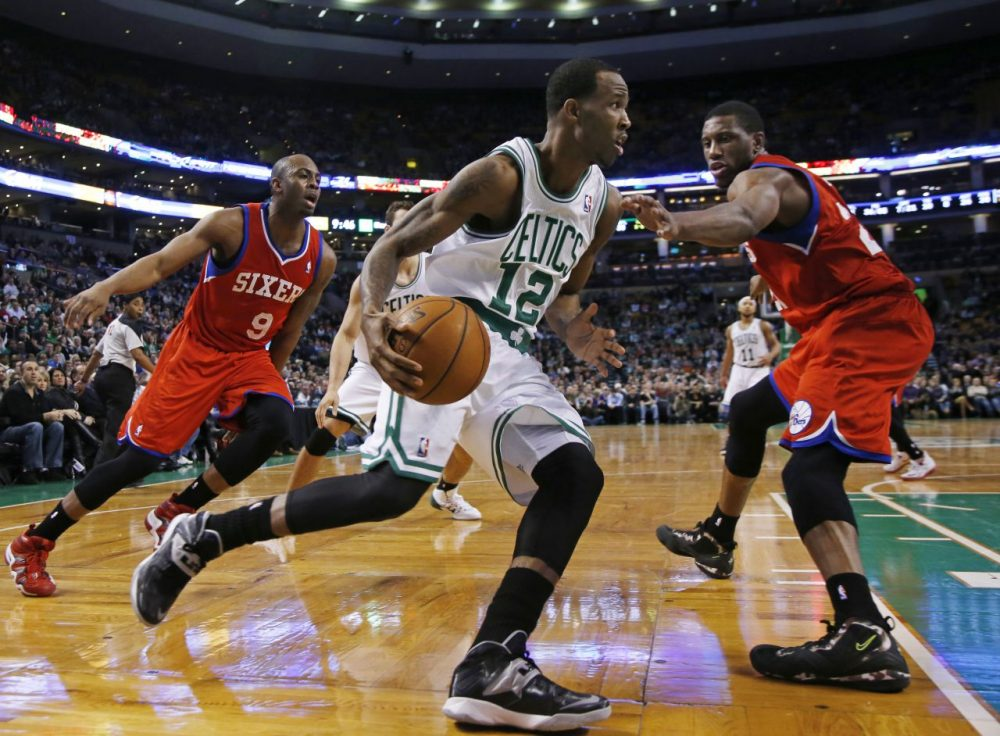 Boston Celtics small forward Chris Johnson (12) drives against Philadelphia 76ers guard James Anderson (9) and forward Thaddeus Young, right. (AP/Elise Amendola)