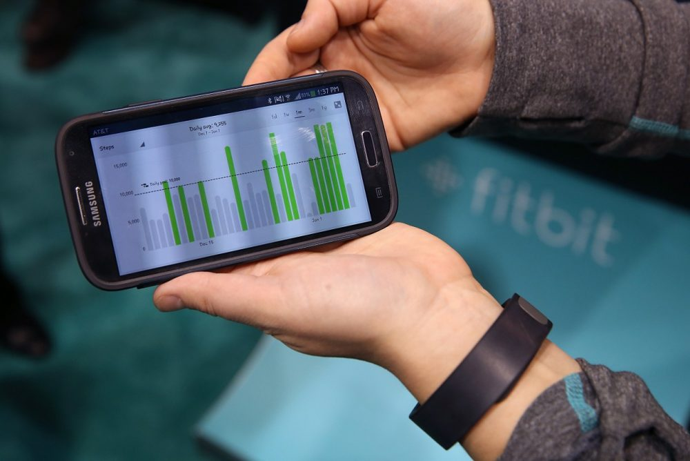 Data collected from the Fitbit Force is displayed on a smartphone in the Fitbit booth at the 2014 International CES at the Las Vegas Convention Center on January 7, 2014 in Las Vegas, Nevada. (Justin Sullivan/Getty Images)