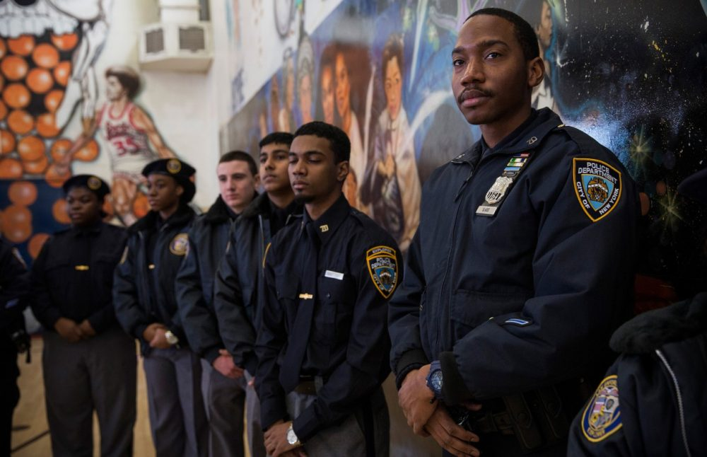 New York City Police Department Explorers attend a press conference held by Mayor Bill DeBlasio announcing the city will not appeal a judge's ruling that the police tactic 'Stop-and-Frisk' is unconstitutional, which the judge had ruled over last summer, on January 30, 2014 in in the Brownsville neighborhood of the Brooklyn borough of New York City. (Andrew Burton/Getty Images)